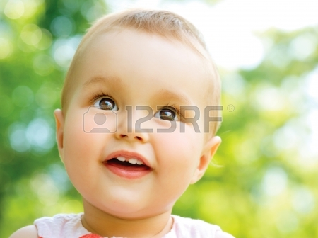 20104811-little-baby-girl-portrait-outdoor-child-over-nature-background
